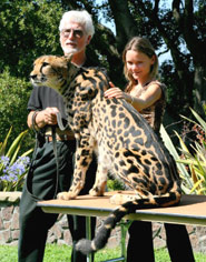 Rob Dicely and Kgosi with Rebecca Klein, founder of Cheetah Conservation Botswana